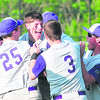 Ticonderoga's Jarryn Granger gets mobbed by his teammates after hitting the game-winning single against Northern Adirondack during Tuesday's Section VII Class C baseball championship game at Chip Cummings Field in Plattsburgh.<br><br>(ROB FOUNTAIN/STAFF PHOTO)