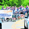 Special Olympics athletes and law-enforcement officers run across the bridge on Cumberland Avenue in the City of Plattsburgh on Thursday, also charged with moving the Flame of Hope along. Today's schedule had the torch carried through Saranac Lake to Lake Placid and from Lewis to Elizabethtown.<br><br>(ROB FOUNTAIN/STAFF PHOTO)