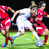Peru's Jessy Dick splits a pair of Massena defenders, Kainan Provost (left) and Darick Gonyea, during Wednesday's NYSPHSAA Class A regional semifinal boys' soccer game at the Plattsburgh High Athletic Complex. The Indians won, 2-0.<br><br>(GABE DICKENS/P-R PHOTO)