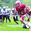 Beekmantown running back Justin Stevens breaks a tackle for extra yards during the season opener against Peru in September. Stevens set a new single-season rushing record in the Class B championship game against Peru.<br><br>(GABE DICKENS/P-R PHOTO)