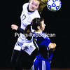 Northern Adirondack's Paige Chilton beats a Potsdam opponent to a loose ball during Wednesday's NYSPHSAA Class C regional semifinal girls' soccer game at the Plattsburgh High Athletic Complex. The Bobcats fell to the Sandstoners, 2-0.<br><br>(GABE DICKENS/P-R PHOTO)