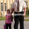 Chazy Central Rural School teacher Cory Thompson walks his granddaughter Aubree Finlayson into school on her first day of pre-K Thursday. Most area schools in the North Country started school Thursday, though staff reported earlier. <br><br>(ROB FOUNTAIN/STAFF PHOTO)