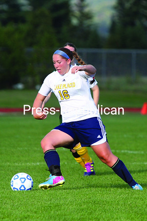 Lake Placid senior Carissa Kennedy moves the ball upfield during Thursday's game against Elizabethtown-Lewis. The Blue Bombers won 3-0.  <br><br>()