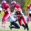 Saranac's Hunter Church tries to break a tackle by a Peru defender during the 2013 season. Now a senior, Church has switched from full back to tail back and is expected to be a key player for the Chiefs.<br><br>(File Photo)