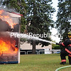 Plattsburgh City Fire Department members Bobby Donahue (left) and Nick Seiden put out the mock dorm-room fire Thursday during Campus Fire Safety Day at SUNY Plattsburgh. The event included a high-rise rescue, the smoke trailer, City Inspector Joe McMahon talking about off-campus safety and a driving simulator. It is part of Campus Fire Safety and National Preparedness Month.<br><br>(ROB FOUNTAIN/STAFF PHOTO)