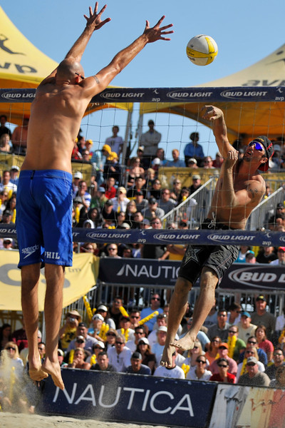 14 September 2008:  Sean Rosenthal shoots as Phil Dalhausser attempts to block during the men's final match of the AVP Crocs Cup Shootout at Pier 30 in San Francisco, CA.  Jake Gibb and Rosenthal defeated Dalhausser and Todd Rogers 11-21, 21-19, 15-13.