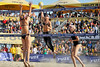14 September 2008:  Misty May-Treanor takes a shot as Nicole Branagh attempts to block during the women's final match of the AVP Crocs Cup Shootout at Pier 30 in San Francisco, CA.  May-Treanor and Kerri Walsh defeated Elaine Youngs and Branagh 21-16, 21-12.