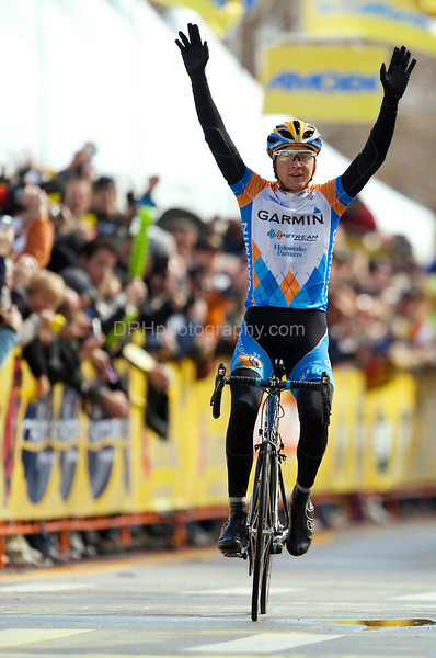 16 February 2009: Thomas Peterson (USA) raises his arms in triumph as he crosses the finish line after winning stage 2 of the Tour of California, in Santa Cruz, CA.