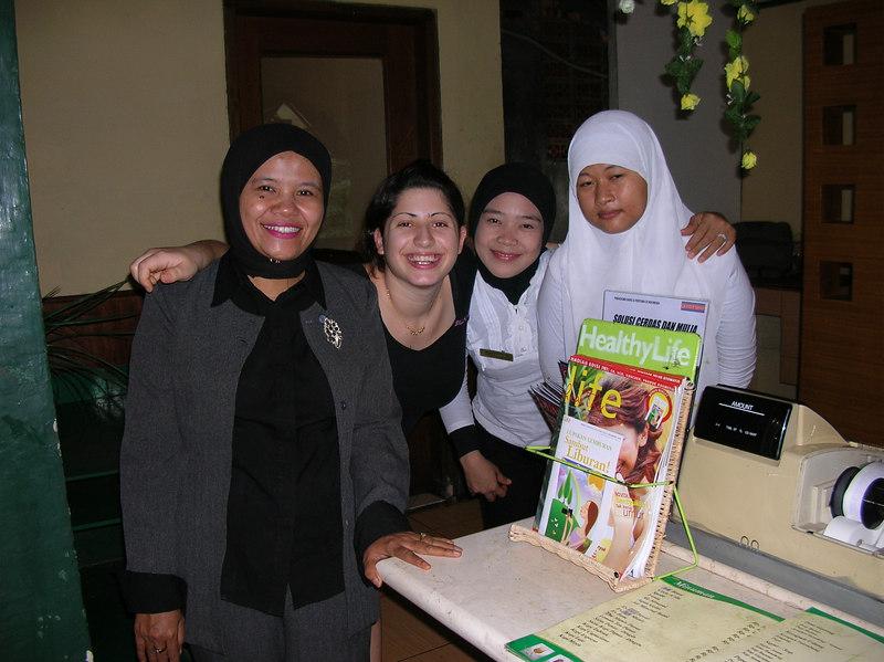 Lauren posing with restaurant staff