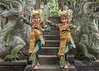 Pair of traditional Balinese dancers and a macaque at the Dragon Bridge, Monkey Forest Temple, Ubud, Bali
