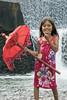 Girl with a red umbrella, Tukad Unda Dam, Bali, Indonesia