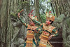 Balinese dancers on the Dragon Bridge with ficus roots, Sacred Monkey Forest Sanctuary, Ubud, Bali