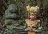 Balinese dancer with Buddha statue, Sacred Monkey Forest Sanctuary, Ubud, Bali