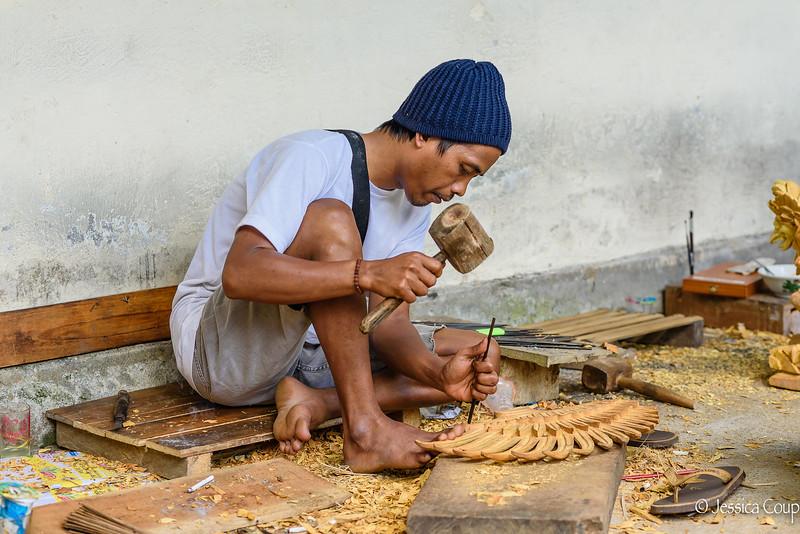 Woodworker Carving Garuda