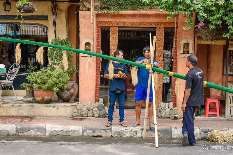 Men Preparing Their Poles