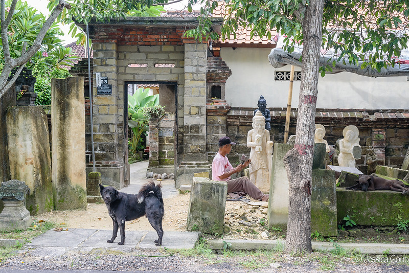 Stone Carver with His Guard Dogs