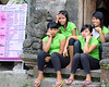 Bored staff outside the Pratama Spa on the Monkey Forest Road in Ubud, Bali, Indonesia in June 2011.