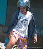 A woman with a motorbike helmet somewhere between Denpasar and Ubud in Bali, Indonesia in June 2011. Her t-shirt says always be with you