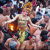 "Dancer amongst the ""monkey men"" and camera toting tourists. Uluwatu."