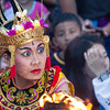 Fire reflected on to the dancer's face. Kecak Dance, Uluwatu.