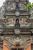 Ornate carvings upper levels Pura Desa Hindu temple, Ubud, Bali
