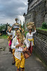 Worshippers with offerings of flowers and food walking to the upper terraces of Pura Penataran Agung, Bali, Indonesia