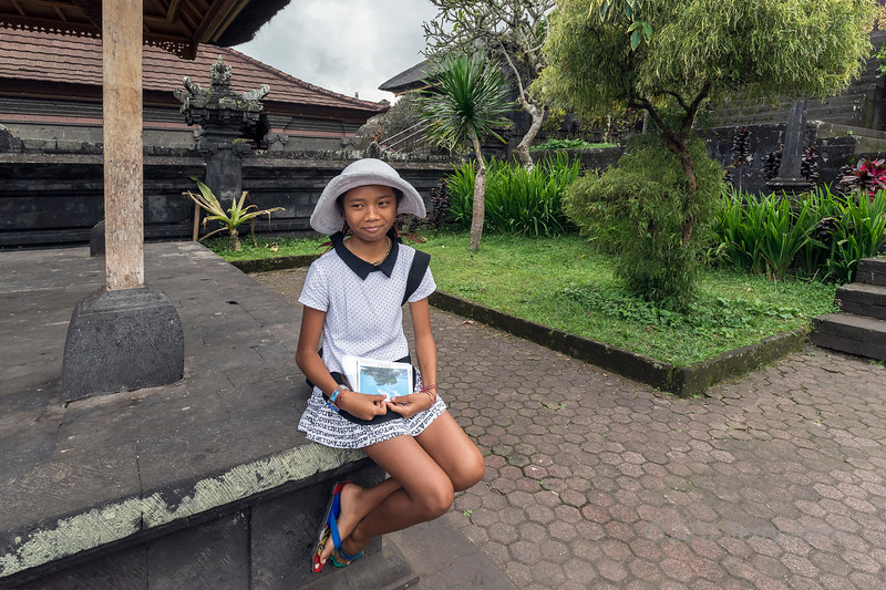I came across this delightful young miss in one of the upper courtyards of Pura Penataran Agung in the Pura Beskih temple complex, Bali, Indonesia. She was selling postcards in at least 6 different languages, and I had fun with her exhausting my more limited language skills.  Since the courtyard was empty at the time, she paused in her sales pitch to pose for a few photos.