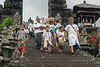 Family of worshipers with wet rice grains on their foreheads at the Pura Besakih Temple, Mount Agung, Bali, Indonesia