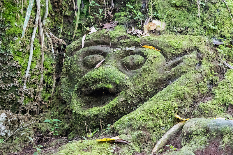 Moss-covered monkey god, Goa Gajah temple, Ubud, Bali Island, Indonesia