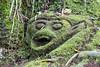 Moss-covered monkey god, Goa Gajah temple, Ubud, Bali Island, Indonesia