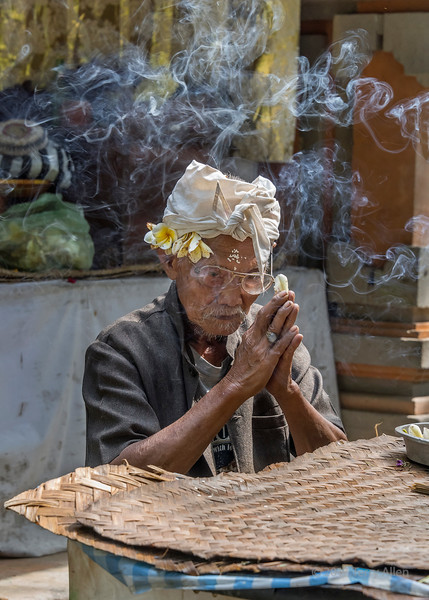 Temple attendant with incense