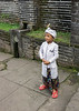 Young boy in tradiitonal attire on his way to the upper terraces of Pura Penataran Agung to pray, Bali, Indonesia