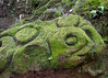Ancient ruined moss-covered statue, Goa Gajah, Ubud, Bali Island, Indonesia