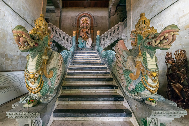 Ornate dragon staircase, old mansion, Ubud, Bali