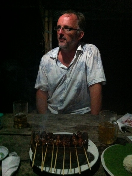 Sate Gule (Chicken Satay) delivered on its own charcoal brazier. Some mad Aussie bloke in the background