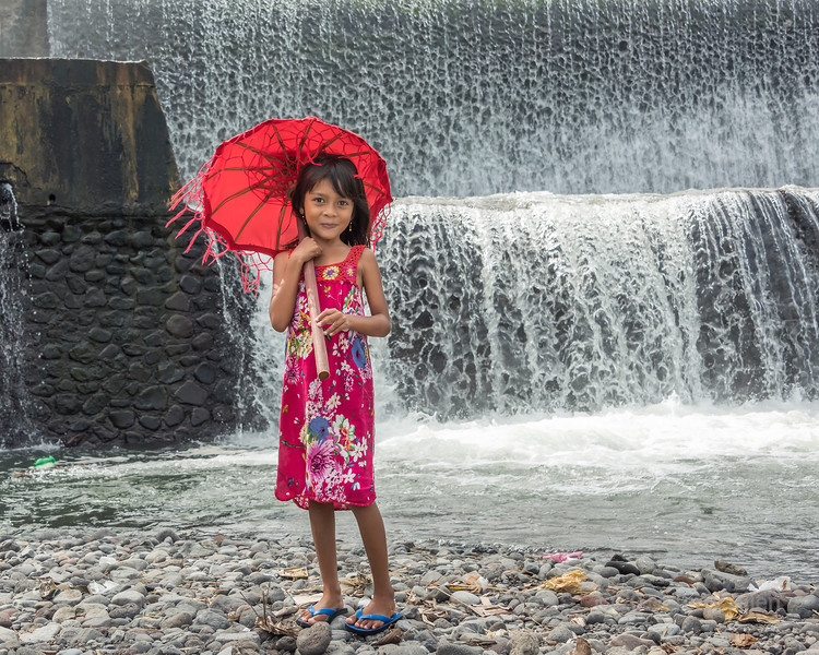 Girl by a waterfall