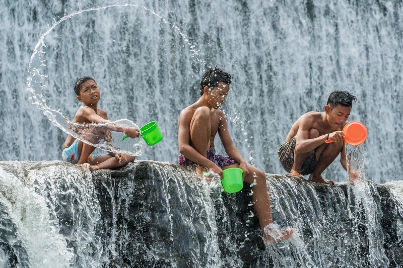Fun with water, Tukad Unda Dam, Klongklong, Bali, Indonesia