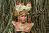 Portrait of a Balinese dancer against ficus roots, Monkey Forest, Ubud, Bali