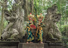 Pair of traditional Balinese dancers at the Dragon Bridge, Monkey Forest Temple, Ubud, Bali