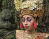 Balinese dancer with traditional makeup and eyes closed, Monkey Forest, Ubud, Bali