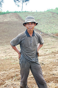 a farmer poses for a photo