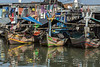 Traditional fishing boats with reflections and laundry, Sunda Kelapa Harbour, Jakarta, Indonesia