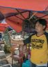 Fish vendor with a large spiny lobster, Sunda Kelapa Pasar Ikan, Jakarta, Indonesia
