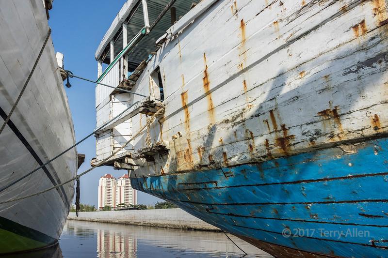 View through the pinisi, Sunda Kelapa harbour, Jakarta, Indonesia