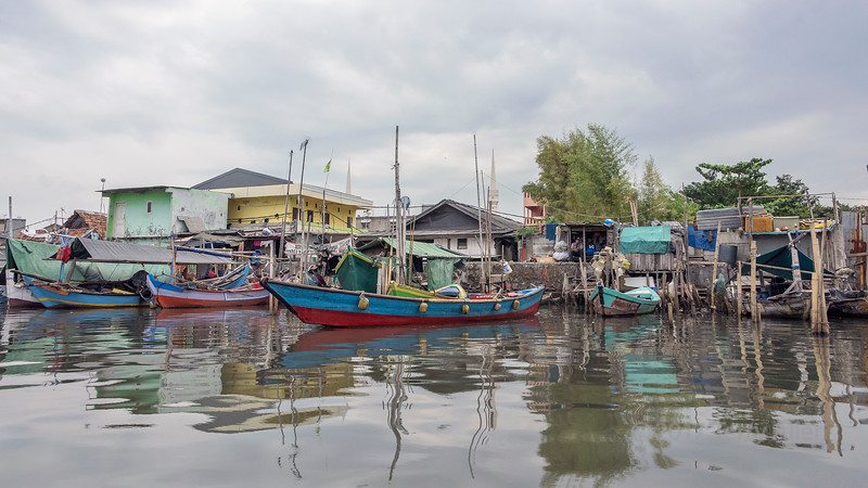 Traditional wooden fishing boats and runabouts in the Sunda Kelapa inner harbour, Jakarta, Indonesia