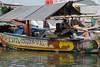 Fisherman asleep on his boat, Sunda Kelapa Harbour, Jakarta, Indonesia