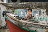The boy with the flute, Sunda Kelapa inner harbour, Jakarta, Indonesia