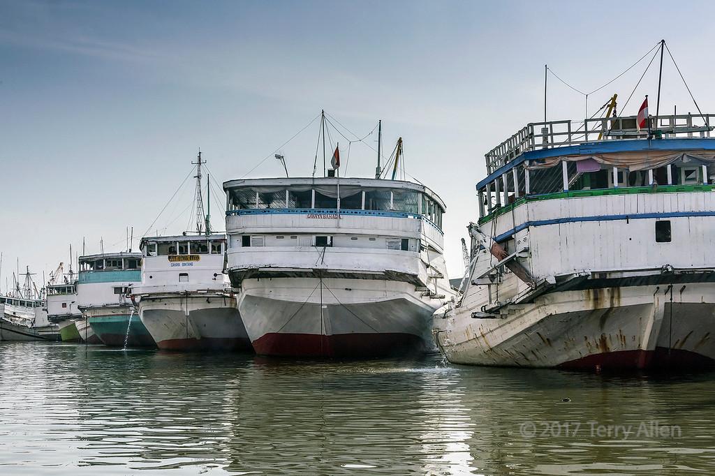 Stern of pinisis tied up to the wharf at Sunda Kelapa harbour, Jakarta, Indonesia