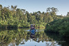 Klotok river boat with reflections, Sekonyer River, Tanjung Puting National Park, Kalimantan, Indonesia