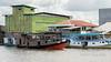 Klotok river boats tied up by the swiftlet hotels in Kumai village, Kalimantan Province, Borneo Island